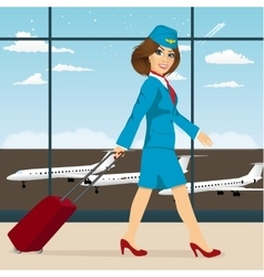 Stewardess with luggage walking vector