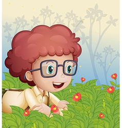 A young boy crawling in the garden vector