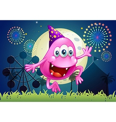A happy pink beanie monster at the carnival vector