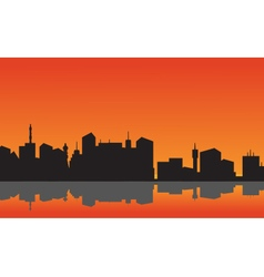 City silhouette reflection in water vector image vector image