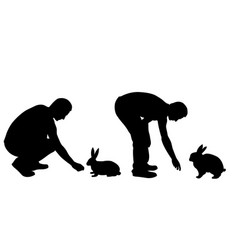 silhouettes of men feeding rabbits vector image vector image