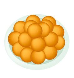 A dish of deep fried sweet potato balls vector