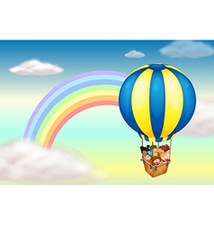 A hot air balloon near the rainbow vector image vector image