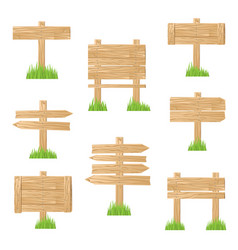 Wooden sign standing in green grass vector