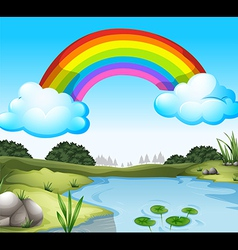A beautiful scenery with a rainbow in the sky vector