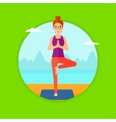 Woman practicing yoga tree pose on the beach vector