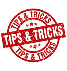 tips tricks round red grunge stamp vector image