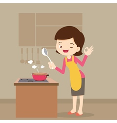 Woman cooking showing ok sign vector