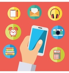 Hand holding cell phone with icons vector