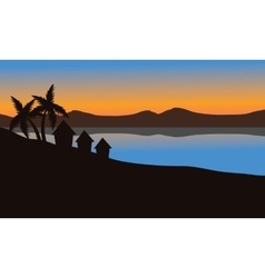 Silhouette of house on the beach vector