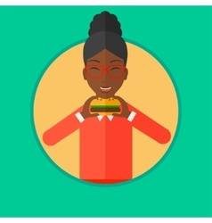 Woman eating hamburger vector