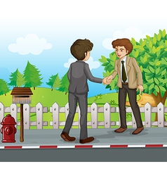 Two businessmen handshaking at the street vector image vector image