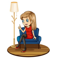 A girl sitting at the blue couch vector