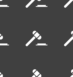 Judge hammer icon seamless pattern on a gray vector