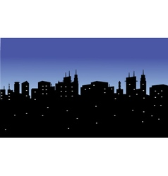 Silhouette of the city with twinkling lights vector