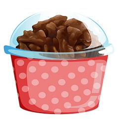A cupcake inside the pink polkadot container vector image