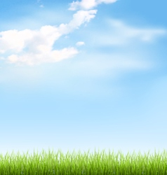 Grass lawn with clouds on blue sky vector
