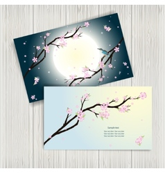 Business cards with stylized cherry blossom vector image vector image
