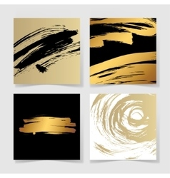 set of four black and gold ink brushes grunge vector image