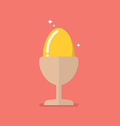 Golden egg in eggcup vector