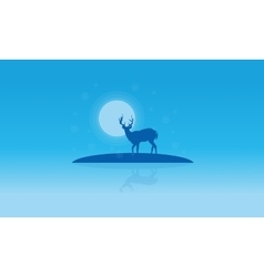 Silhouette of deer with reflection christmas vector