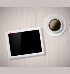 Cup of coffee and a digital tablet on the table vector