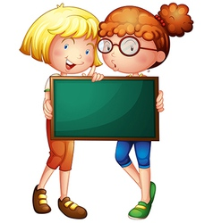 Two girls holding a green board vector image