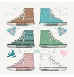 Variations of sketched sneakers vector
