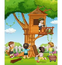Children playing at the treehouse in the garden vector