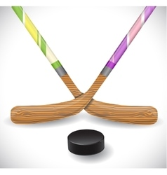 Hockey sticks and hockey puck vector