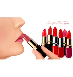 Lipsticks and happy female lips vector