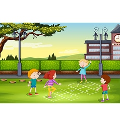 Children playing hopscotch in the park vector image