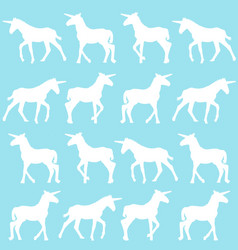 Unicorn silhouettes over blue background vector