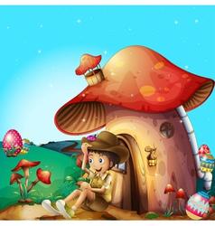 A boy at his mushroom house vector