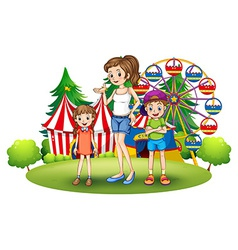 A family at the amusement park with a ferris wheel vector image vector image