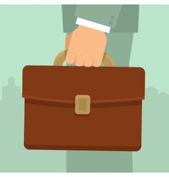 businessmans hand holding briefcase vector image