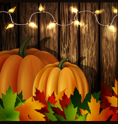 Autumn leaves and pumpkins on wooden texture vector