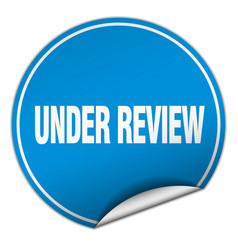 under review round blue sticker isolated on white vector image vector image