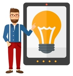 Man pointing at tablet computer with light bulb on vector