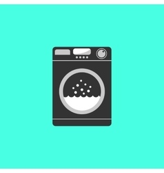 black washing machine isolated on green background vector image