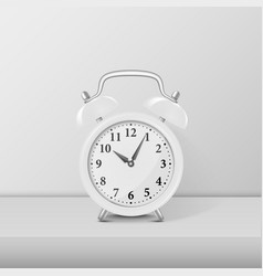 white alarm clock closeup standing on white table vector image vector image