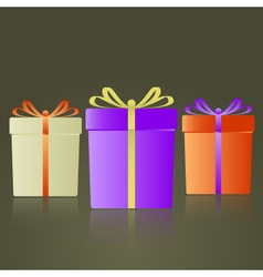 Three colorful gifts with ribbons reflection eps10 vector
