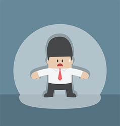 Businessman caught in spotlight beam vector