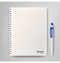 Spiral notebook with the white ballpoint pen vector