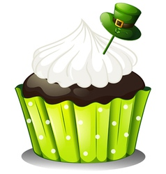 A chocolate cupcake with a white icing and a green vector