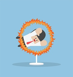 Businessman jumping through the fire hoop vector