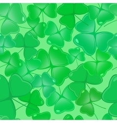 Seamless pattern with shamrock leaves vector