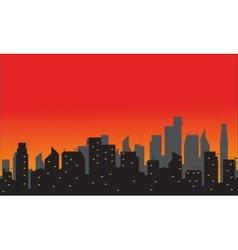 Silhouette of city with red background vector image