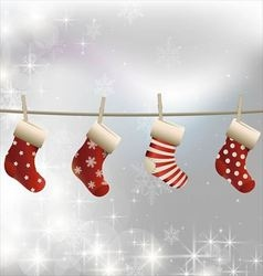 Hanging christmas socks on a clothesline vector