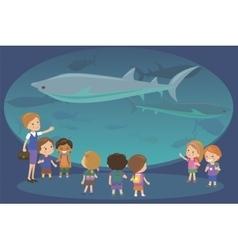 Group of kids watching sharks at oceanaruim vector image